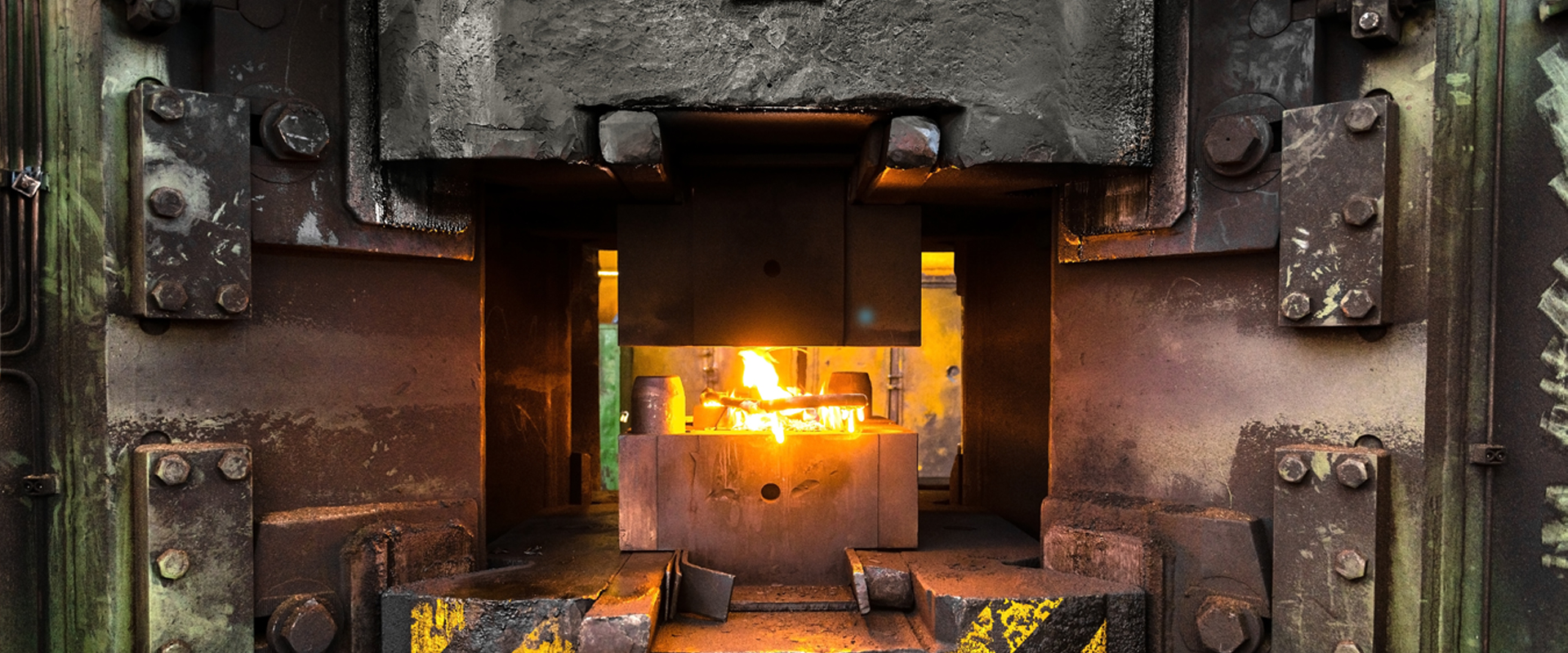 Liquid Molten Steel Industry: Worker pouring liquid metal into crucible.
